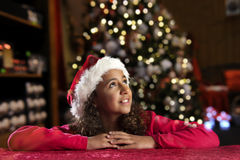 Girl with christas hat on black Royalty Free Stock Images