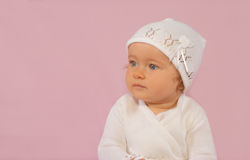 Girl in christening outfit Stock Photography