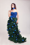 Girl in christimas tree fantasy dress on grey background Royalty Free Stock Images