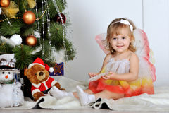 Girl at a Christmas. Little girl at a Christmas fir-tree royalty free stock images