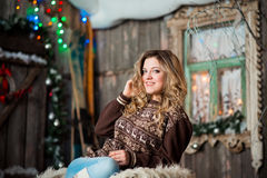 Girl with Christmas around porch. New year Royalty Free Stock Photography
