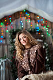 Girl with Christmas around porch Stock Photography