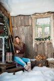 Girl with Christmas around porch Stock Photos