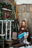 Girl with Christmas around porch Royalty Free Stock Image