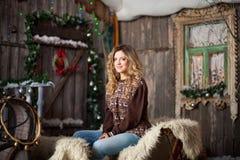 Girl with Christmas around porch Stock Photo