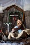 Girl with Christmas around porch Royalty Free Stock Photos