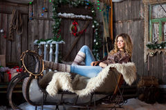 Girl with Christmas around porch Royalty Free Stock Photo