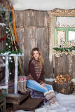 Girl with Christmas around porch Royalty Free Stock Photography