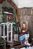 Girl with Christmas around porch Stock Image