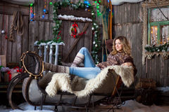 Girl with Christmas around porch. New year Royalty Free Stock Image