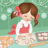 Girl and Christmas baking ginger cookies Stock Photos