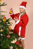 Girl with the christmas balls. Funny stylization about christmas holidays Royalty Free Stock Photography