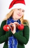 Girl with Christmas balls Royalty Free Stock Photo