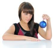 Girl with Christmas balls Stock Photography