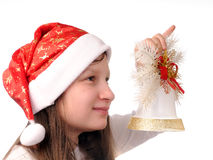 Girl with christmas bell Stock Photo