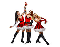 Girl and Christmas bells. Attractive young women in carnival costumes and Christmas bells isolated on a white background Royalty Free Stock Photo