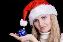 Girl with christmas bulb Royalty Free Stock Images