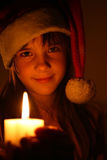 Girl with christmas candle. Light look to you Stock Image