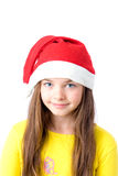Girl in christmas cap Stock Image