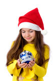 Girl in christmas cap Stock Images