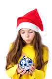 Girl in christmas cap Stock Photos