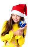 Girl in christmas cap Stock Photography