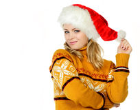Girl in a christmas cap Royalty Free Stock Photo