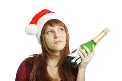 The girl in a Christmas cap Royalty Free Stock Photo