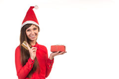 Girl in christmas cap with card and red gift box Stock Photo