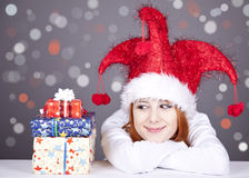 Girl in christmas cap with gift boxes. Royalty Free Stock Images