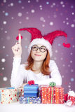 Girl in christmas cap with gift boxes. Stock Photo