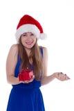 Girl in a Christmas cap gift to rejoice Stock Photos