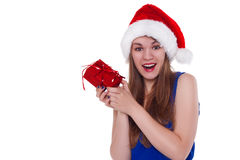 Girl in a Christmas cap gift to rejoice Royalty Free Stock Photo