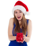 Girl in a Christmas cap gift to rejoice Royalty Free Stock Image