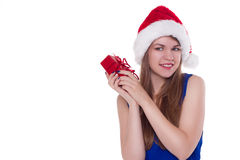 Girl in a Christmas cap gift to rejoice Royalty Free Stock Images