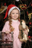Girl in a Christmas cap Royalty Free Stock Image
