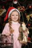 Girl in a Christmas cap Royalty Free Stock Photography