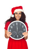 Girl in christmas with a clock with twelve o'clock Royalty Free Stock Photos