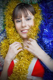 Girl in Christmas clothes. Decorated with garlands Stock Photo