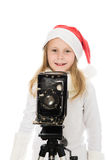 Girl in a Christmas costume with old camera Stock Photo