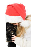 Girl in a Christmas costume with old camera Stock Photography