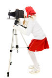 Girl in a Christmas costume with old camera Stock Images