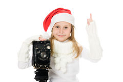 Girl in a Christmas costume with old camera Royalty Free Stock Image