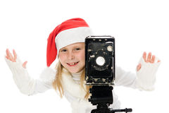 Girl in a Christmas costume with old camera Royalty Free Stock Photos