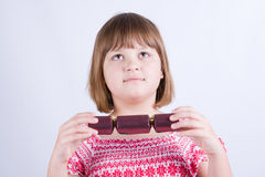 Girl with Christmas crackers Stock Photos