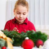 Girl with christmas decoration Stock Photography