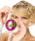 Girl with Christmas decoration. Beautiful blond girl with Christmas-tree decorations Stock Image