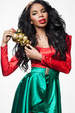 Girl with Christmas decoration. Elegant mulatto girl with Christmas decoration stock photo
