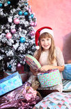 Girl with christmas decoration and tree Stock Photos
