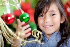 Girl with Christmas decorations Stock Photography